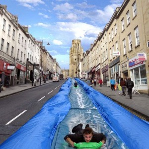PARK AND SLIDE – ARTIST TO TURN STREET INTO WATERSLIDE